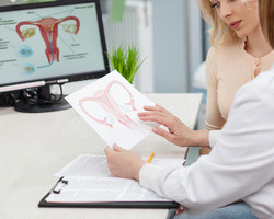 photo-fino-woman-reading-about-uterine-fibroids-test