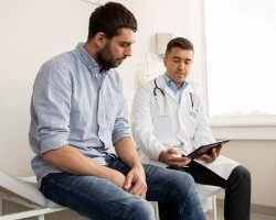 photo-doctor-and-man-conversing-test
