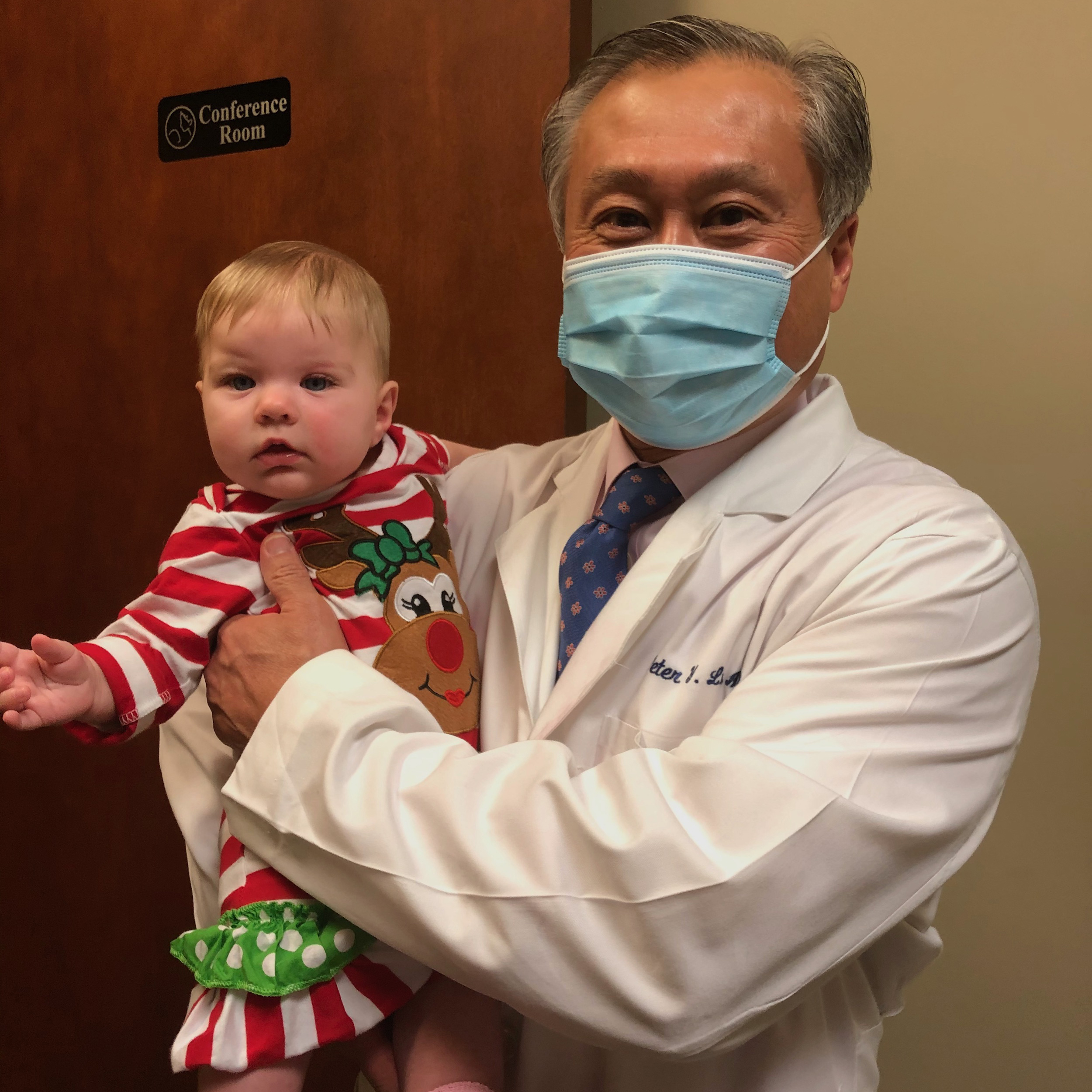 Dr. Lu with baby Elise Marie, who was conceived after secondary infertility.