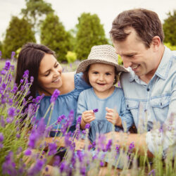 Couple with their child outside | about our fertility clinic | The Fertility Institute of New Orleans | Baton Rouge and Mandeville, LA