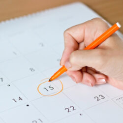 photo-fino-woman-looking-at-calendar-for-ivf-due-date-test